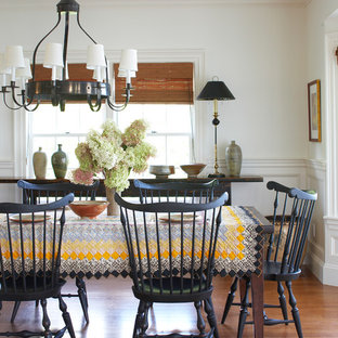 Elegant brown floor dining room photo in Boston with white walls