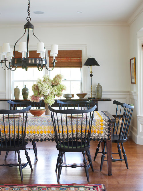 Traditional Dining Room In Boston With White Walls And Brown Floor