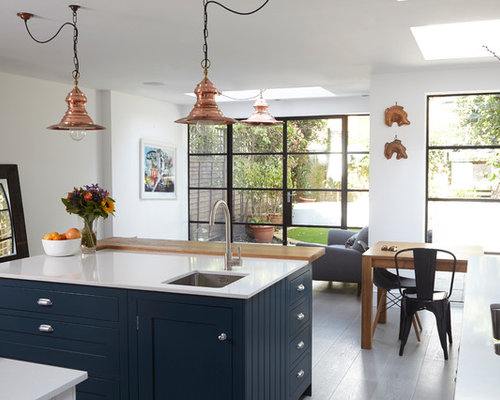Inspiration for a bohemian kitchen dining room in london with white walls