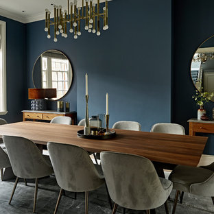 Design ideas for a medium sized midcentury enclosed dining room in London with blue walls, light hardwood flooring and brown floors.