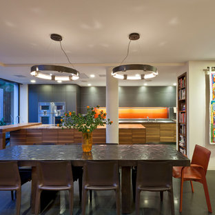 Design ideas for a contemporary kitchen/dining room in London with beige walls and grey floors.