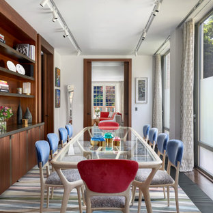 Design ideas for a contemporary enclosed dining room in London with white walls and no fireplace.
