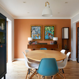 Inspiration for a traditional kitchen/dining room in London with orange walls, medium hardwood flooring and brown floors.