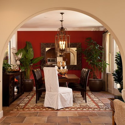 Example of a mid-sized tuscan slate floor enclosed dining room design in San Diego with beige walls and no fireplace