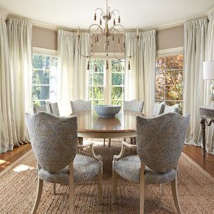 Elegant medium tone wood floor dining room photo in Miami with beige walls