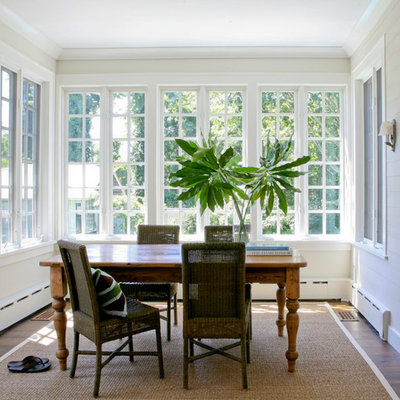 Dining room - traditional dark wood floor dining room idea in New York with white walls