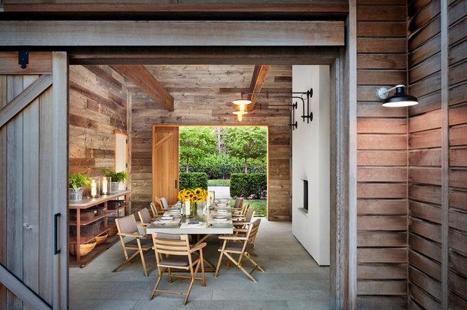 Rustic Dining Room by John Hummel & Associates Custom Builders