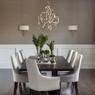 Transitional dark wood floor and wainscoting dining room photo in New York with gray walls