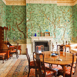 Photo of a classic enclosed dining room in Other with multi-coloured walls and a standard fireplace.