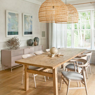 Example Of A Coastal Medium Tone Wood Floor And Brown Enclosed Dining Room Design In