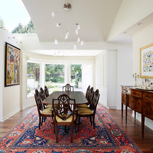 Inspiration for an eclectic medium tone wood floor and brown floor dining room remodel in Minneapolis with white walls