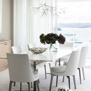 This is an example of a contemporary dining room in Sydney with grey walls, carpet and white floor.
