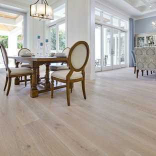 Inspiration for a large transitional light wood floor and beige floor kitchen/dining room combo remodel in Miami with no fireplace and white walls