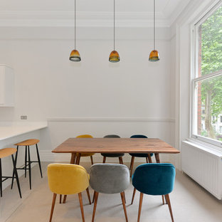 Photo of a medium sized contemporary kitchen/dining room in London with white walls, porcelain flooring and beige floors.