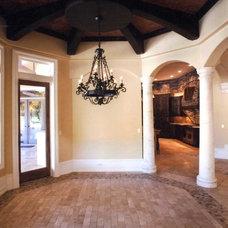 Mediterranean Dining Room by Renderings and Interiors