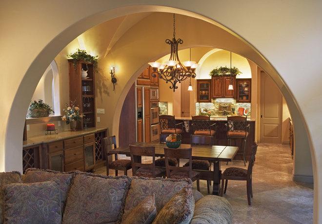Mediterranean Dining Room by Vanguard Studio Inc.