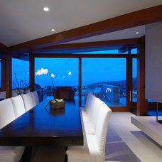 Contemporary Dining Room by Aria Design Inc