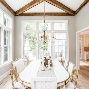Example of a coastal light wood floor and beige floor dining room design in Philadelphia with gray walls