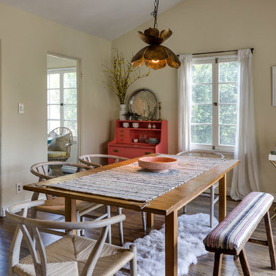 Example of a mid-sized trendy brown floor and medium tone wood floor enclosed dining room design in Los Angeles with beige walls and no fireplace