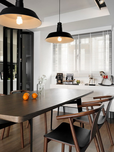 Fusion Dining Room by SpaceArt Interior Designers & Decorators