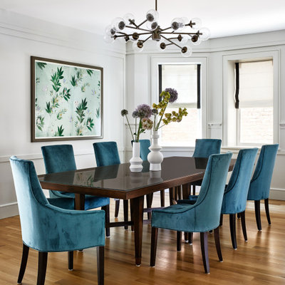 Large transitional medium tone wood floor and brown floor dining room photo in Los Angeles with gray walls