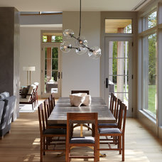Transitional Dining Room by James Merrell Architects, P.C.