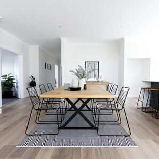 Photo of a scandinavian dining room in Perth with white walls, medium hardwood floors and brown floor.