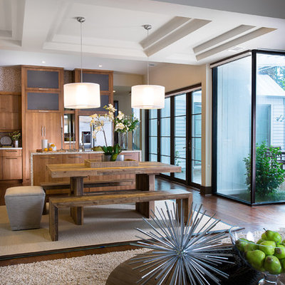 Example of a mid-sized trendy dark wood floor great room design in Atlanta with beige walls