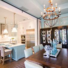 Tropical Dining Room by Glenn Layton Homes