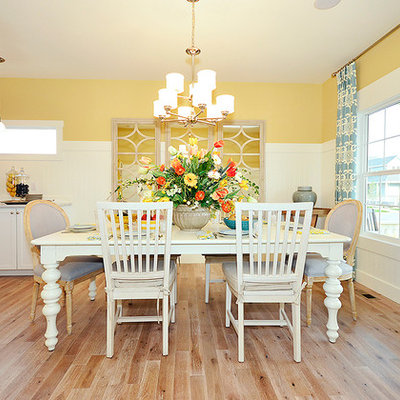 Kitchen/dining room combo - traditional medium tone wood floor kitchen/dining room combo idea in Denver with yellow walls