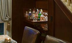Hidden Staircase Storage for liquor bar