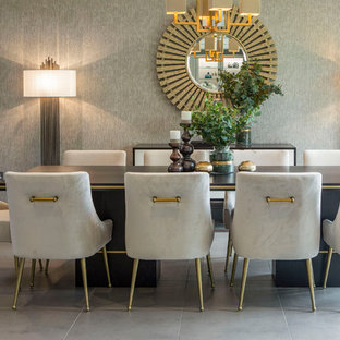 Inspiration for a classic dining room in Surrey with grey walls and grey floors.