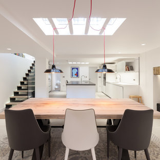Inspiration for a medium sized contemporary kitchen/dining room in London with white walls and beige floors.