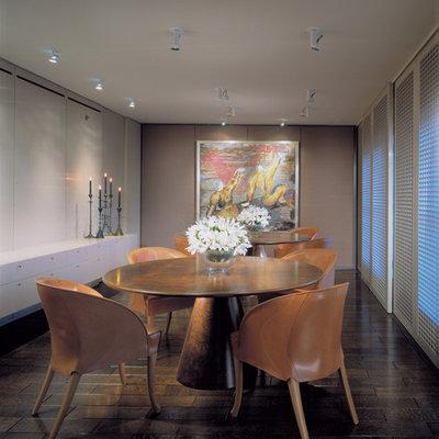 Trendy dark wood floor dining room photo in Chicago with beige walls