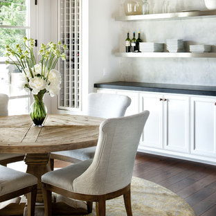 Example of a mountain style dark wood floor and brown floor dining room design in Austin
