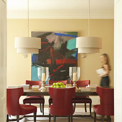 Dining room - transitional dark wood floor dining room idea in Los Angeles with beige walls