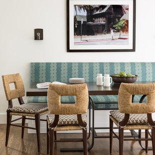 Great room - mediterranean medium tone wood floor and brown floor great room idea in San Francisco with white walls