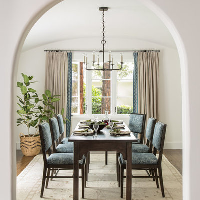 Inspiration for a mediterranean dark wood floor and brown floor enclosed dining room remodel in San Francisco with white walls