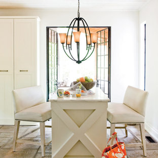 Elegant dining room photo in Cleveland with white walls