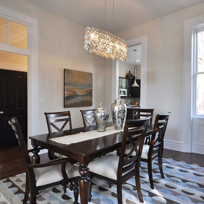 Example of a mid-sized classic dark wood floor enclosed dining room design in St Louis with beige walls
