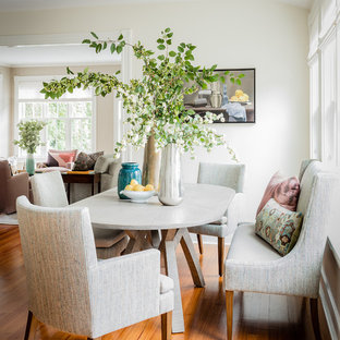 Example Of A Small Classic Medium Tone Wood Floor Dining Room Design In  Boston With White