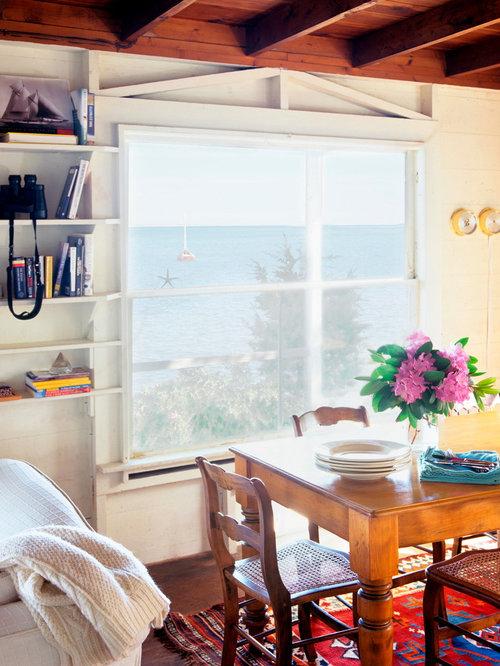 sala da pranzo aperta verso il soggiorno al mare con camino ad ... - Design Soggiorno Pranzo 2