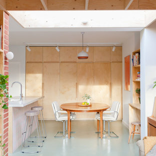 Medium Sized Scandinavian Open Plan Dining Room In London With Concrete Flooring White Walls