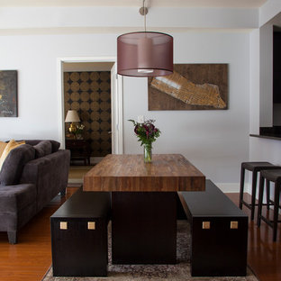 Inspiration for a mid-sized contemporary medium tone wood floor great room remodel in New York with gray walls and no fireplace