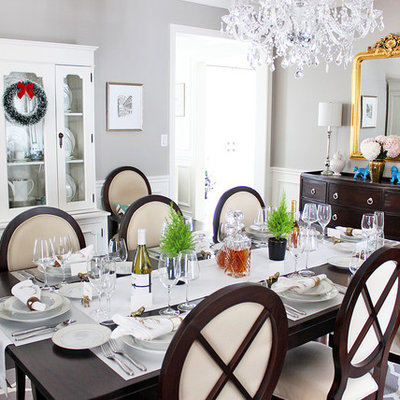 Inspiration for a transitional dark wood floor enclosed dining room remodel in Toronto with gray walls