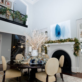 Large transitional dark wood floor kitchen/dining room combo photo in Atlanta with blue walls, a standard fireplace and a plaster fireplace