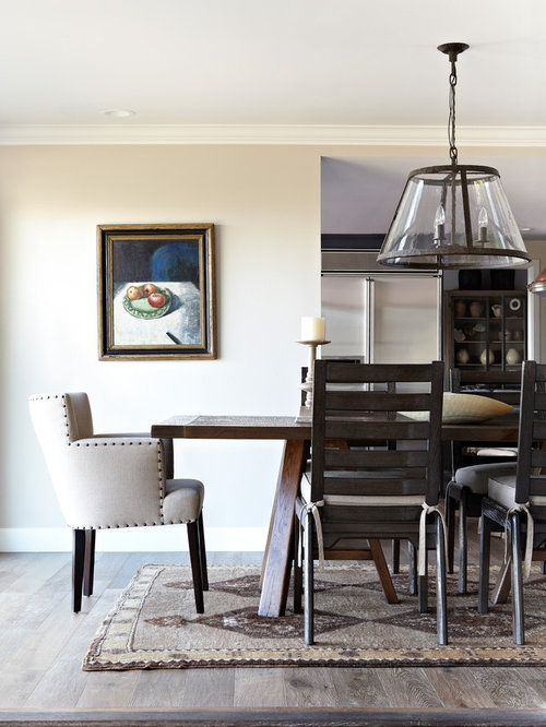 inspiration for a timeless dark wood floor dining room remodel in los angeles with beige walls - Dark Dining Room Table
