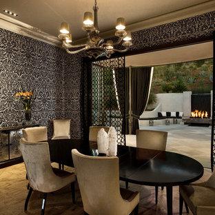 Inspiration for a mid-century modern medium tone wood floor dining room remodel in Santa Barbara