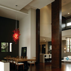 Contemporary Dining Room by Barron Development Corp.
