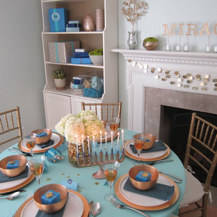 Inspiration for a transitional dining room remodel in Bridgeport with blue walls and a standard fireplace